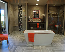 Porcelain patterns mixed, glass band added to complete a transitional bathroom for Him & Her. As they soak away in a Bain Ultra Charism Air Tub.